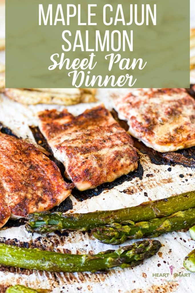 pinterest image: sheet pan with veggies and salmon baked. Writing at the top: Maple Cajun Salmon sheet pan dinner.