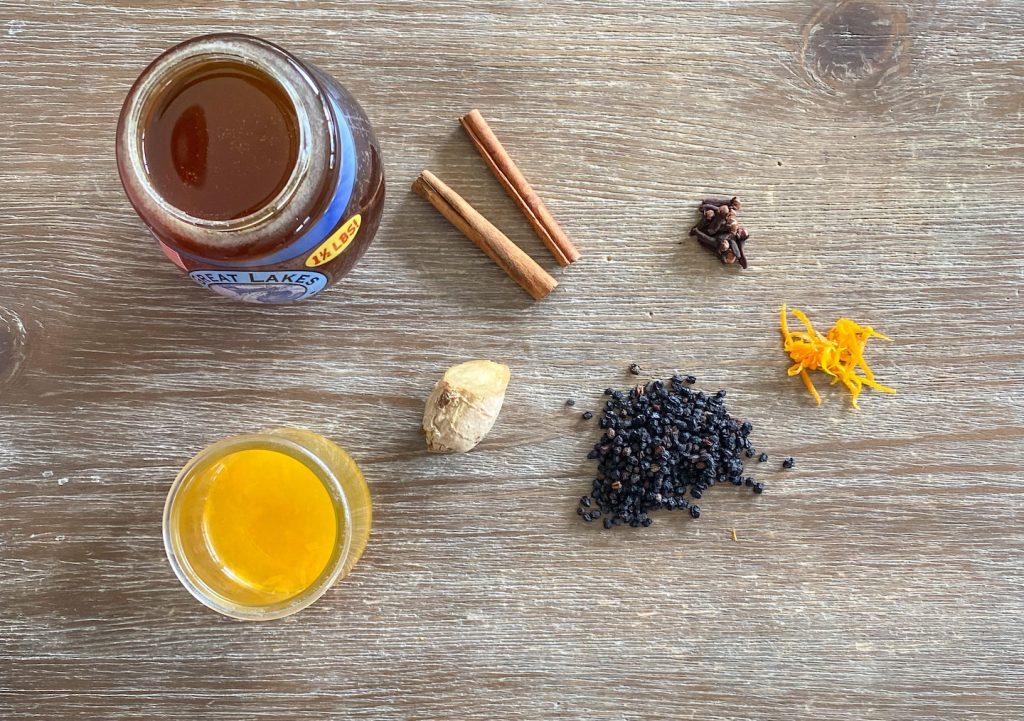 honey, cinnamon  sticks,  cloves, ginger, elderberries, orange juice, and orange zest.